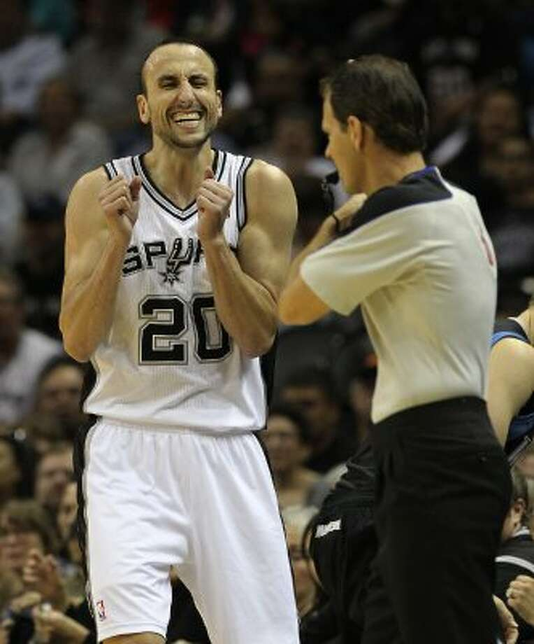 Spurs' Manu Ginobili (20) cringes after a play against the Minnesota Timberwolves at the AT&T Center on Wednesday, Mar. 21, 2012. Kin Man Hui/Express-News. (San Antonio Express-News)