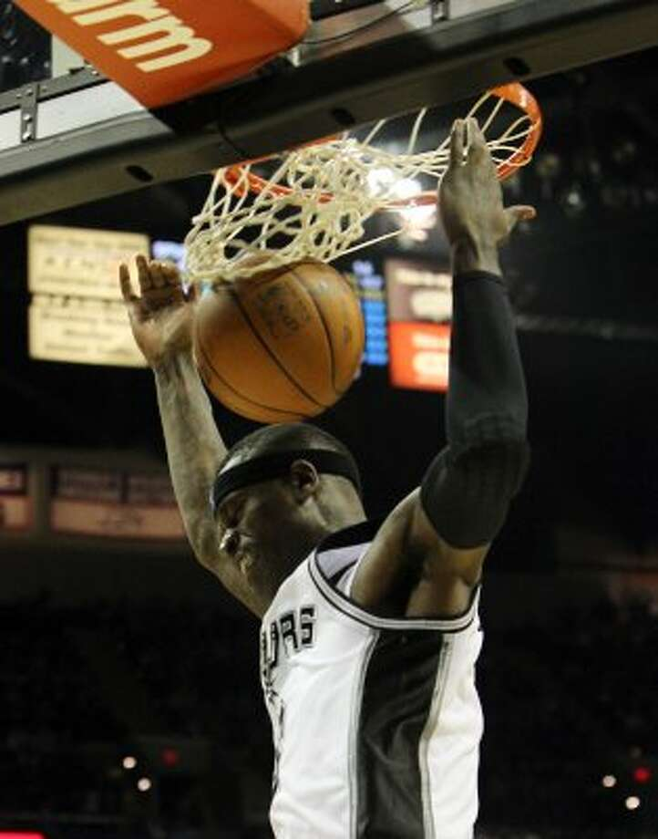 Spurs' Stephen Jackson (03) dunks against the Minnesota Timberwolves at the AT&T Center on Wednesday, Mar. 21, 2012. Kin Man Hui/Express-News. (San Antonio Express-News)