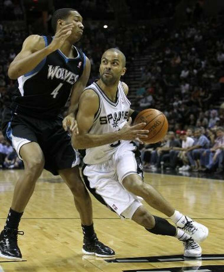 Spurs' Tony Parker (09) drives to the goal against Minnesota Timberwolves' Wesley Johnson (04) at the AT&T Center on Wednesday, Mar. 21, 2012. Kin Man Hui/Express-News. (San Antonio Express-News)