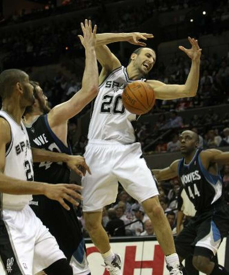 Spurs' Manu Ginobili (20) loses control of the ball against Minnesota Timberwolves' Kevin Love (42) at the AT&T Center on Wednesday, Mar. 21, 2012. Kin Man Hui/Express-News. (San Antonio Express-News)