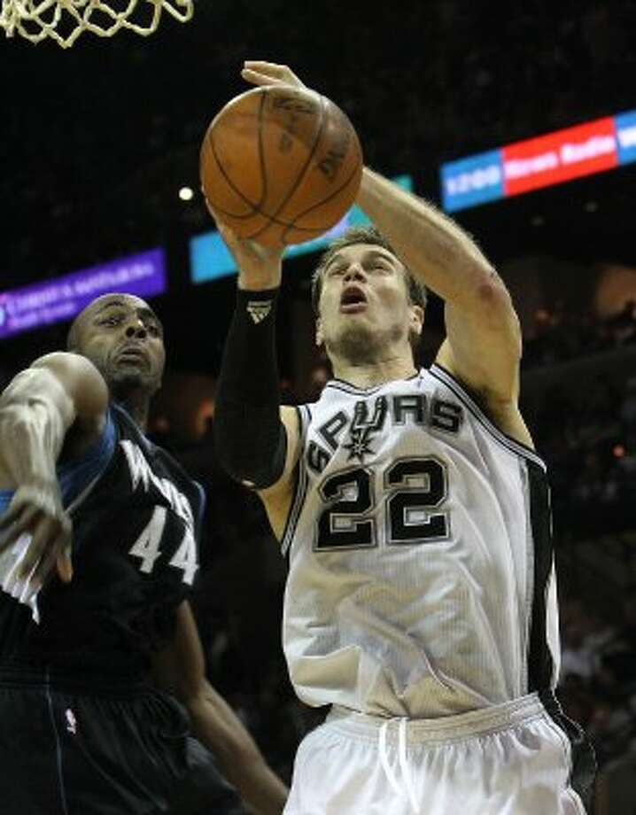 Spurs' Tiago Splitter (22) gets a shot blocked by Minnesota Timberwolves' Anthony Tolliver (44) at the AT&T Center on Wednesday, Mar. 21, 2012. Kin Man Hui/Express-News. (San Antonio Express-News)