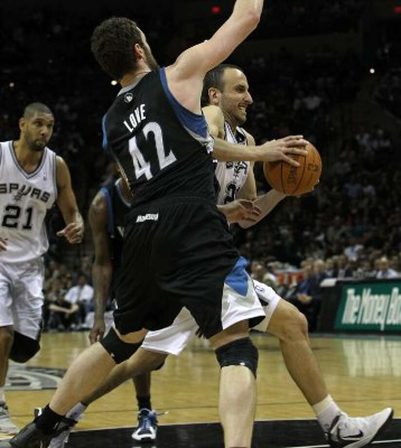 Spurs' Manu Ginobili (20) drives to the basket against Minnesota Timberwolves' Kevin Love (42) at the AT&T Center on Wednesday, Mar. 21, 2012. Kin Man Hui/Express-News. (San Antonio Express-News)