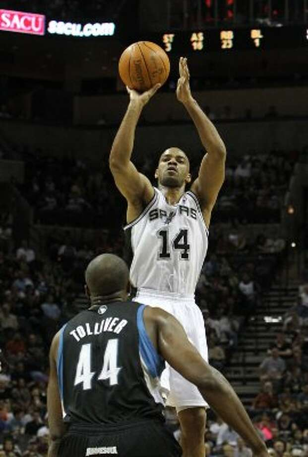 Spurs' Gary Neal (14) attempts a shot against Minnesota Timberwolves' Jose Barea (11) and Anthony Tolliver (44) at the AT&T Center on Wednesday, Mar. 21, 2012. Kin Man Hui/Express-News. (San Antonio Express-News)