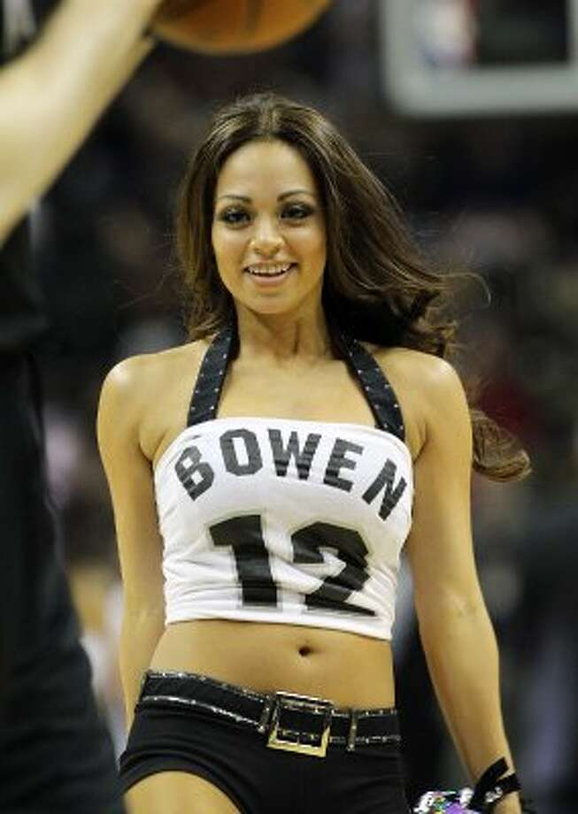 Silverdancers sport tops with former Spurs Bruce Bowen name and number during the Spurs game against the Minnesota Timberwolves at the AT&T Center on Wednesday, Mar. 21, 2012. Bowen was honored during a jersey retirement ceremony after the game. Kin Man Hui/Express-News. (San Antonio Express-News)