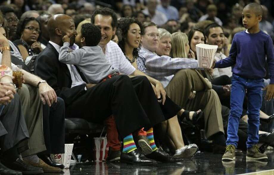 Former Spurs Bruce Bowen (left) gets a kiss from his youngest son, Ozmel, while attending a Spurs game against the Minnesota Timberwolves at the AT&T Center on Wednesday, Mar. 21, 2012. Bowen is being honored during a jersey retirement ceremony. Kin Man Hui/Express-News. (San Antonio Express-News)