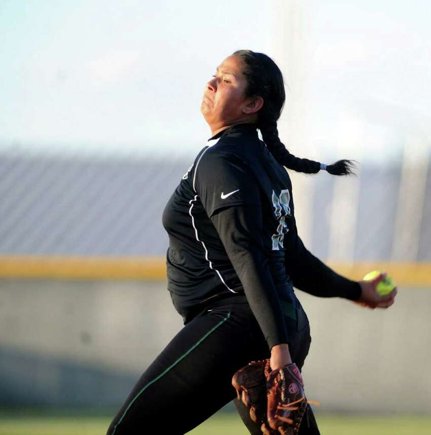 Kamerie Vidales of Southwest delivers a pitch during softball action at East Central High School on Wednesday, March 21, 2012. Billy Calzada / San Antonio Express-News