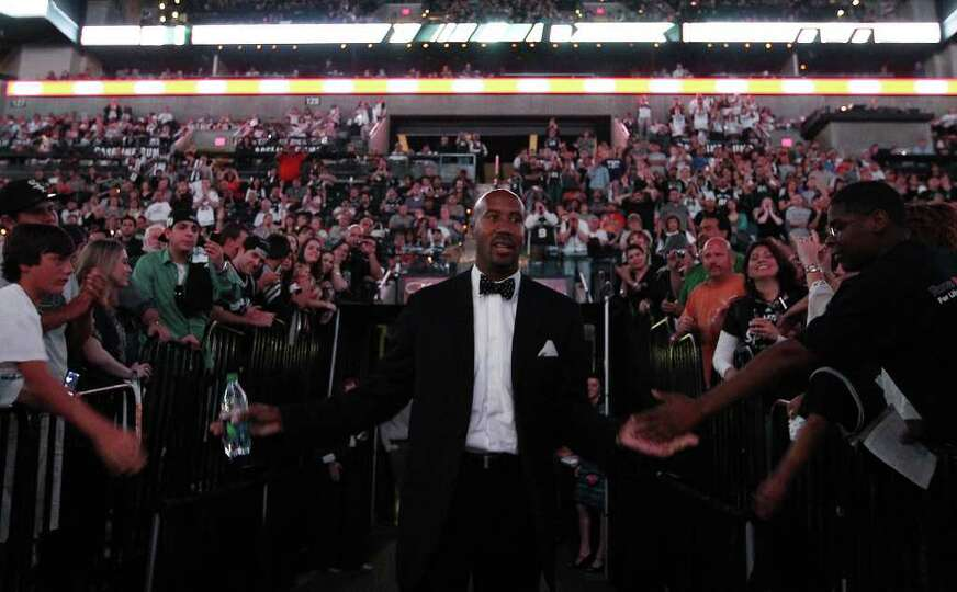 Former Spurs forward Bruce Bowen walks out of the players tunnel one last time as he is honored in a