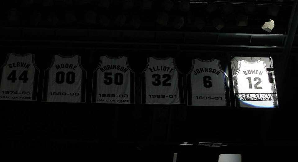 Former Spurs forward Bruce Bowen's jersey is revealed during a ceremony after the Spurs-Minnesota Ti