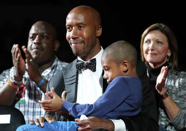 Former Spurs forward Bruce Bowen joined by his son, Ojani, is honored in a ceremony after the Spurs-