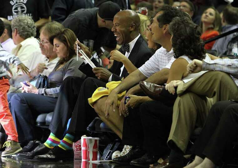 Former Spurs Bruce Bowen laughs while attending a Spurs game  against the Minnesota Timberwolves' at
