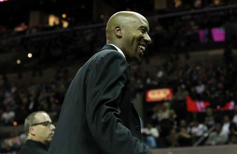 Former Spurs Bruce Bowen smiles at fans during a Spurs game against the Minnesota Timberwolves at th