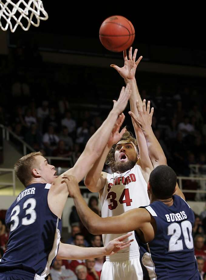 Stanford forward Andrew Zimmermann (34) scores in front of Nevada forward Kevin Panzer (33) and guard Jordan Burris (20) in the first half of a college basketball game in the NIT quarterfinals, Wednesday, March 21, 2012, in Stanford, Calif. Photo: Paul Sakuma, Associated Press
