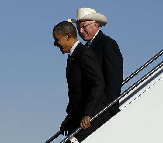 President Barack Obama, left, with Interior Secretary Ken Salazar, right, walk down the stairs during their arrival at Roswell International Air Center airport, March, 21, 2012 in Roswell, N.M. Photo: Pablo Martinez Monsivais, Associated Press