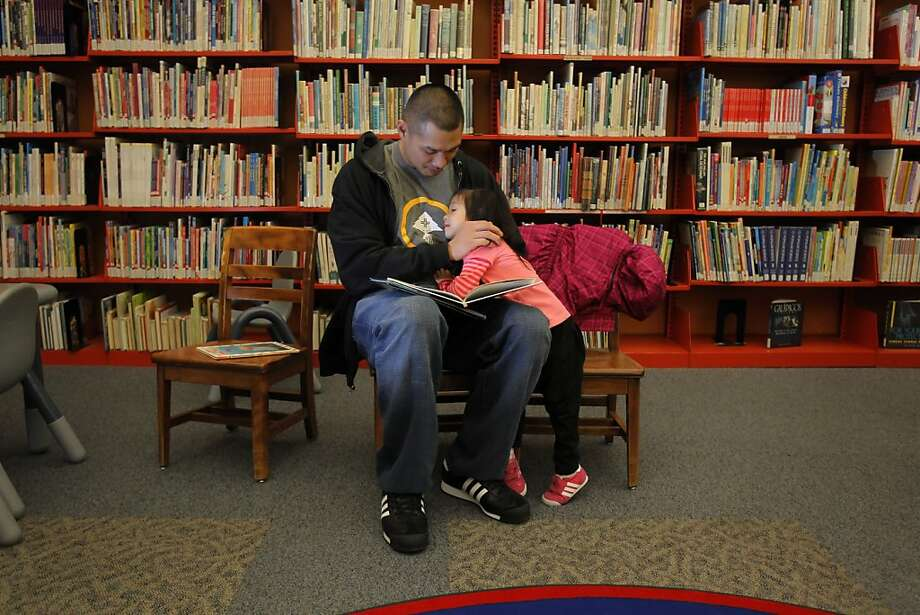 Albert Yee reads to his daughter, Alyssa Yee, 2, in the Serramonte Library in Daly City, Calif., on Wednesday, March 21, 2012. Census figures show that Daly City, Calif., has the highest percentage of Asians, and specifically Filipinos, in the nation. Photo: Carlos Avila Gonzalez, The Chronicle