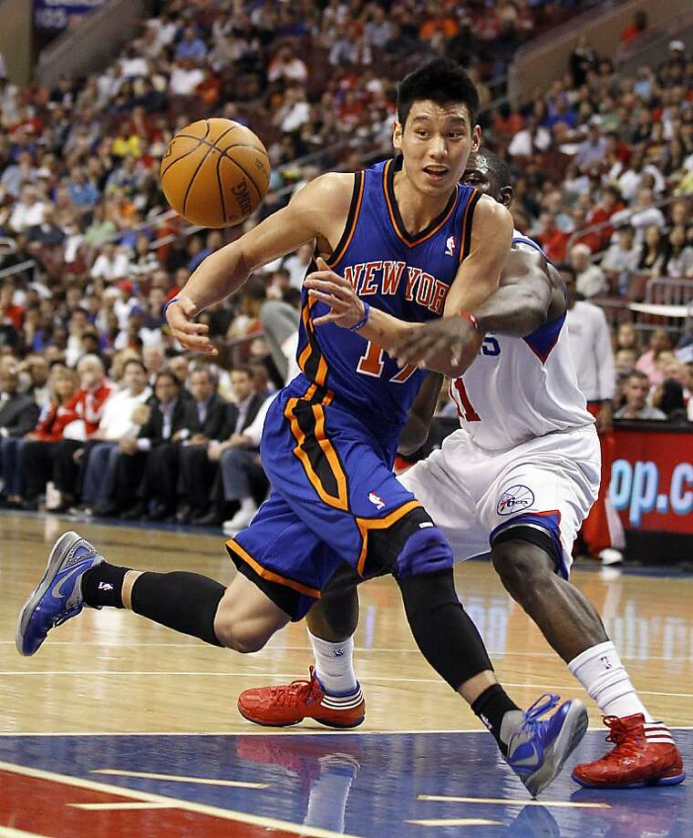 The New York Knicks' Jeremy Lin (17) loses the basketball against the Philadelphia 76ers' Jrue Holiday during the first quarter at the Wells Fargo Center in Philadelphia, Pennsylvania, on Wednesday, March 21, 2012. (Yong Kim/Philadelphia Daily News/MCT) Photo: Yong Kim, McClatchy-Tribune News Service