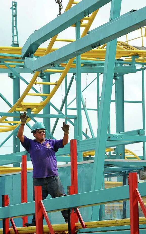 The South Texas State Fair opens its doors today at 6 p.m. Crews worked through out the rainy week to assemble rides like the Crazy Mouse, pictured, and the Himalaya.   Photo taken Monday, March 20, 2012 Guiseppe Barranco/The Enterprise Photo: Guiseppe Barranco, STAFF PHOTOGRAPHER / The Beaumont Enterprise