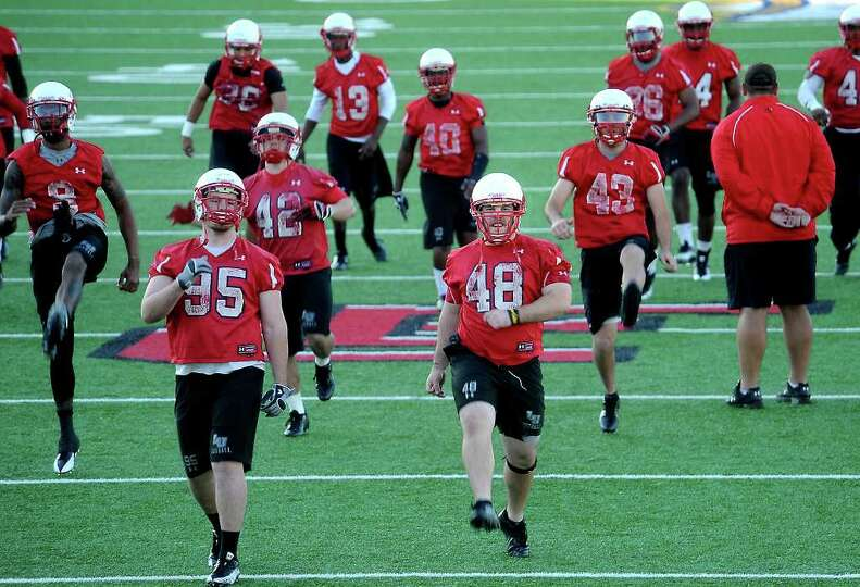 The Lamar Cardinals begins the first day of spring football practice with warm ups at Lamar Universi