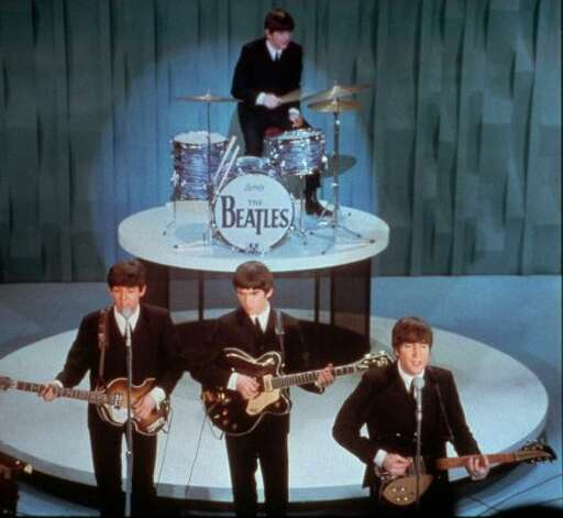 "Team Beatles vs.... : The Beatles, performing on the ""Ed Sullivan Show on Feb. 9, 1964."" (Associated Press)"