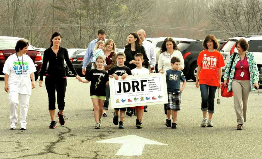 Huckleberry Hill Elementary School in Brookfield sponsored a walk as part of a fundraiser for the Juvenile Diabetes Research Foundation Thursday, March 22, 2012. Among those walking in front are, from left: Karin Prizio, school nurse; Gina DiPaola, her daughter, Talia, 8; Nate Schoeller; Kyle Rosa and Aidan Sarmiere, all 7. The children all have type 1 juvenile diabetes. Photo: Michael Duffy / The News-Times