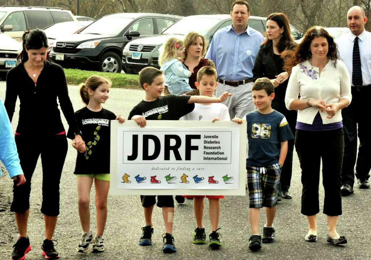 Huckleberry Hill Elementary School in Brookfield sponsored a walk as part of a fundraiser for the Juvenile Diabetes Research Foundation Thursday, March 22, 2012. Among those walking in front are, from left: Gina DiPaola, her daughter, Talia, 8; Nate Schoeller; Kyle Rosa and Aidan Sarmiere, all 7. The children all have type 1 juvenile diabetes.