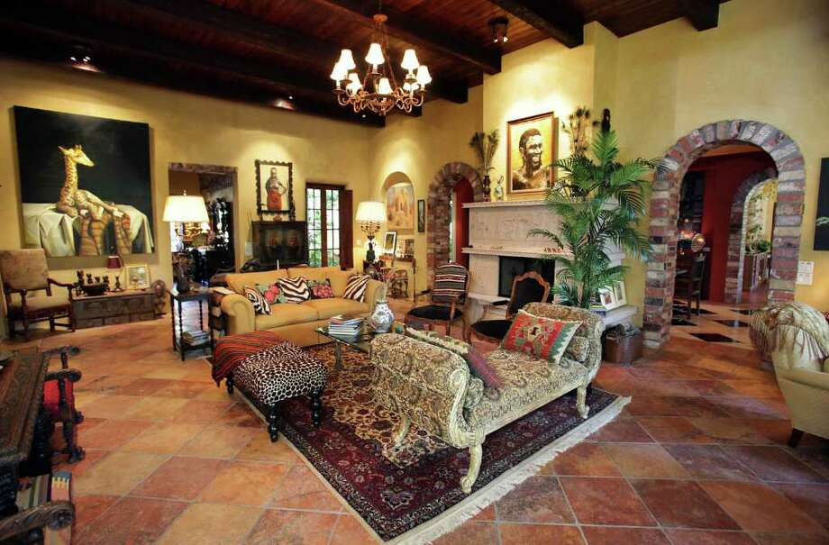 The living room in the home of Suzi and Dennis Strauch near Pipe Creek, shows part of their international art collection. Photo: BOB OWEN, San Antonio Express-News / © 2012 San Antonio Express-News
