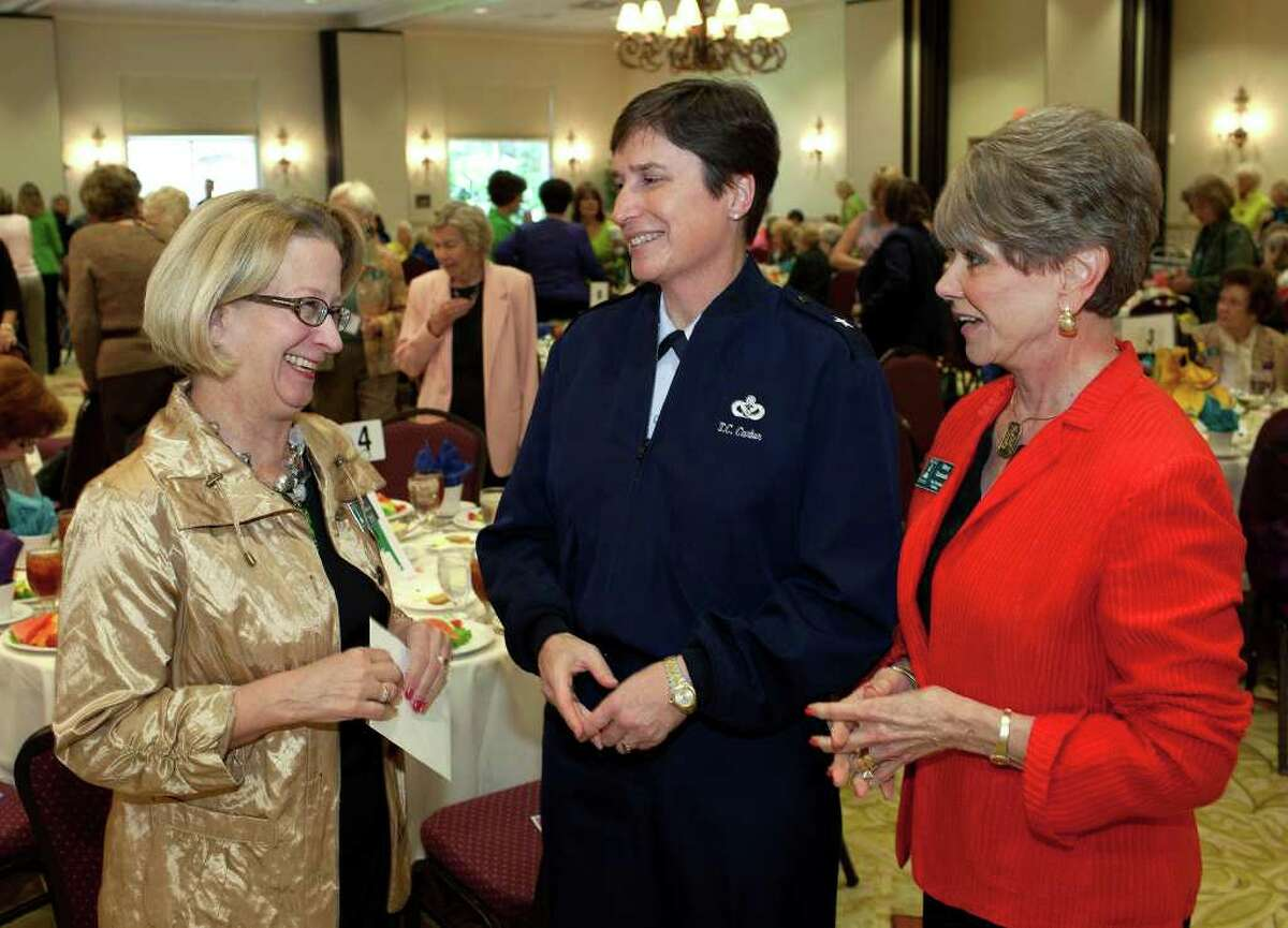 """Julia Whitmore, president military, from the left, USAF Brigadier General Theresa Carter and Mary Carmack, past president civilian, get together for """"Spring Fashions"""" by Andie and Barbara at the Military Civilian Club Luncheon at Oak Hills Country Club, Monday, March 12, 2012."""