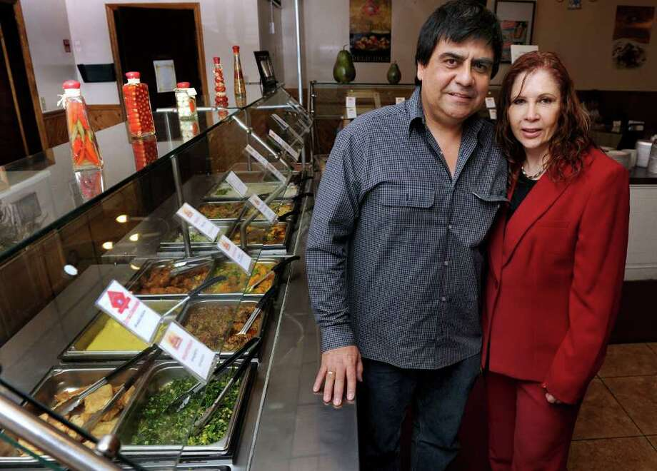 Orlando Alza and Nadir Cavaleiro, owners of Brasilis BBQ on Main Street in Danbury, are photographed in their restaurant Wednesday, March 21, 2012. Photo: Carol Kaliff / The News-Times