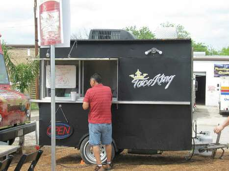 Taco King: Freshness is the name of the game. Azucena Diaz makes fresh corn and flour tortillas inside the trailer for tacos, sopes, chalupas and nachos.