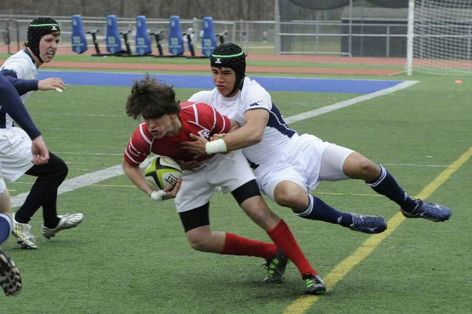 Staples' Jackson Yang, right, tackles a Fairfield Prep player March 15. Yang is a junior captain and a returning starting flanker. Photo: April Book / Contributed Photo