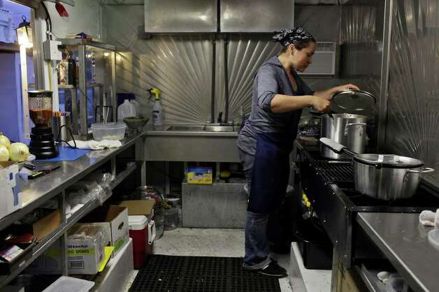 taste - Ana Fernandez makes frito pies in her food truck, The Chili Queens, at Alamo Street Eat Bar on Tuesday, March 20, 2012. LISA KRANTZ/San Antonio Express-News Photo: Lisa Krantz, San Antonio Express-News / @San Antonio Express-News