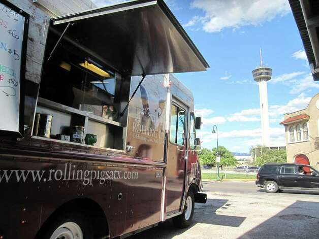 The Rolling Pig food truck is parked at the Alamo Eat Street Bar off of South Alamo in Southtown. The park will have it's grand opening April 3.