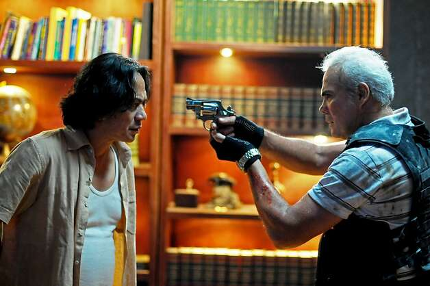 "Left to Right: Ray Sahetapy as Tama and Pierre Gruno as Wahyu in, ""The Raid: Redemption."" Photo: Akhirwan Nurhaidir, Courtesy Of Sony Pictures Classi"