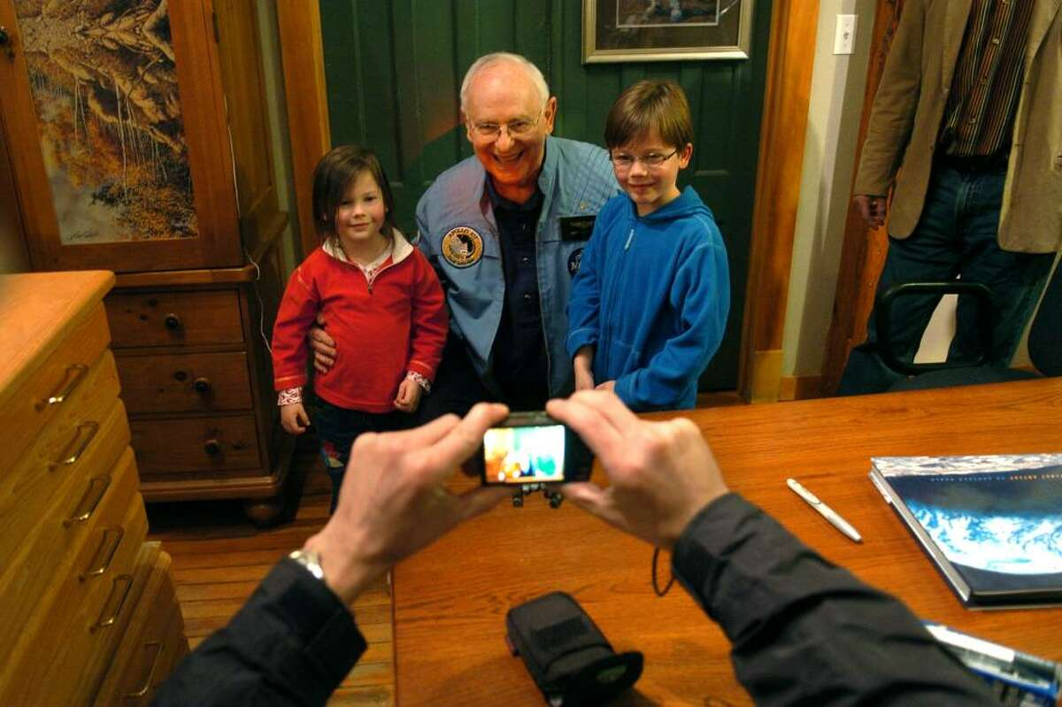 Apollo 12 astronaut Alan Bean, in center, poses for a photo with Mary Harvey, 4, of Fairfield, and her brother Robbie, 6, at the Greenwich Gallery Workshop in Seymour, Conn. on Saturday Nov. 14, 2009. Taking the photo is their father David Harvey. Bean visited the gallery on the 40th anniversary to the day of his launch to the moon. Bean was the fourth human to ever walk on the surface of the moon.