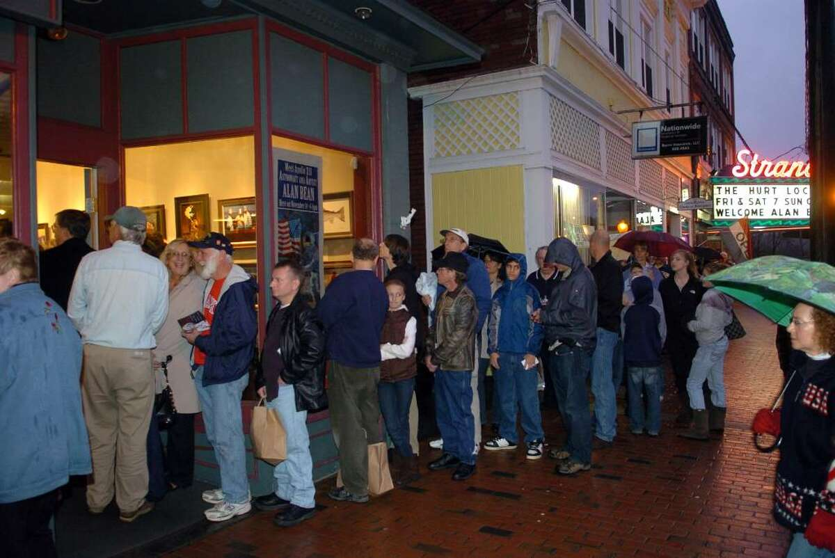 Apollo 12 astronaut Alan Bean spent time signing his book and posters the Greenwich Gallery Workshop in Seymour, Conn. on Saturday Nov. 14, 2009. Here, dozens of people patiently wait in the rain outside the gallery to meet Bean and get his autograph. Bean visited the gallery on the 40th anniversary to the day of his launch to the moon. Bean was the fourth human to ever walk on the surface of the moon.