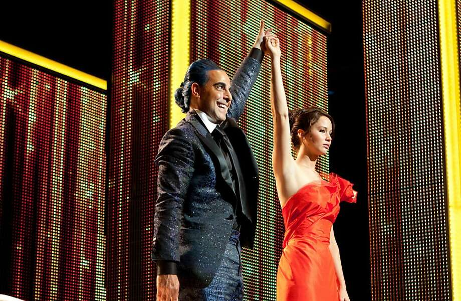 "Caesar Flickerman (Stanley Tucci, left) and Katniss Everdeen (Jennifer Lawrence) star in ""The Hunger Games."" (Courtesy Murray Close/MCT) Photo: Handout, McClatchy-Tribune News Service"