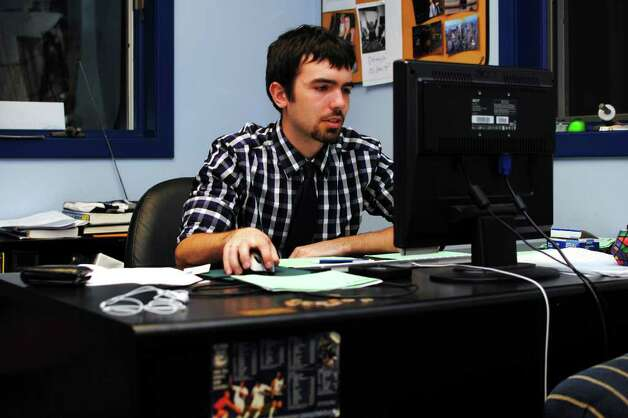 Mac Cerullo, Managing Editor of The Daily Campus, works in the newspaper office on the University of Connecticut campus, in Storrs, Conn. March 21st, 2012. Photo: Contributed Photo/Rachel Weiss, Rachel Weiss\The Daily Campus / Connecticut Post Contributed