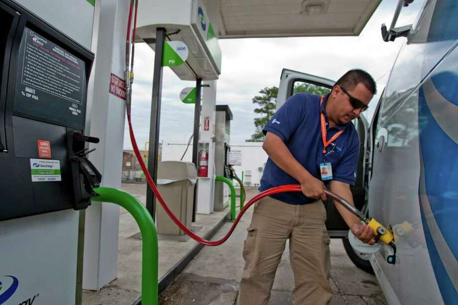 Alejander Ruiz, a premise technical with AT&T, fills up his vehicle with Clean Energy Fuel at a Houston filling station. Photo: Thomas B. Shea, For The Chronicle / © 2012 Thomas B. Shea