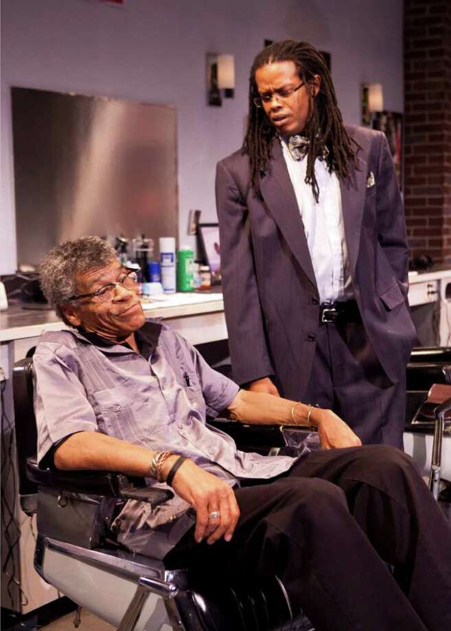 "Houston Chronicle - CUTTIN -The Ensemble Theatre's production of ""Cuttin' Up."" Charles Randolph Wright's comedy looks at the barbershop as a communal center in African-American life.  L-R: Wayne DeHart as Howard, Robert Marshall as Howard Jr. Photo: Bruce Bennett / Houston Chronicle"