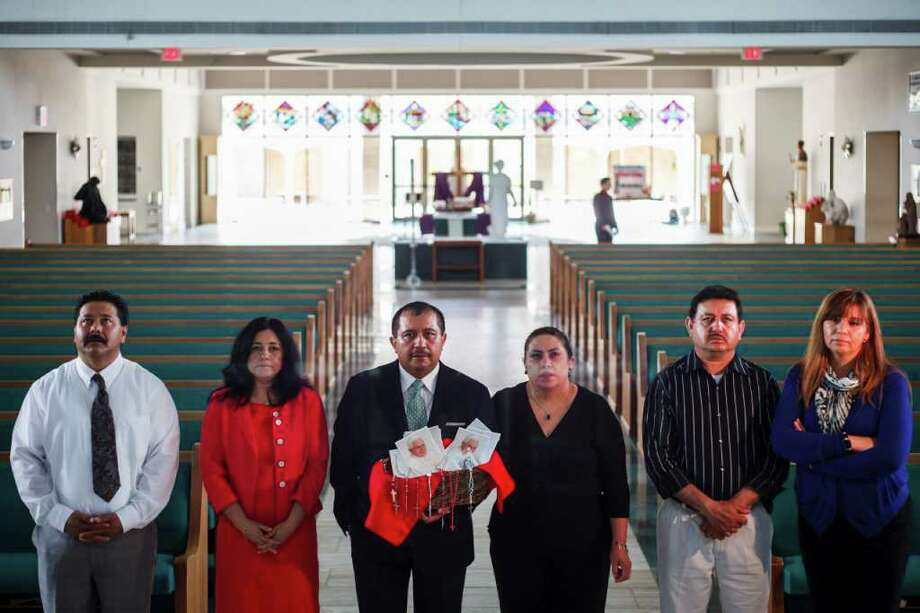 Martin Medina and his wife Rosario, Pedro Salas and his wife Pilar, and Jose Montoya and his wife Maty pray at St. Jerome Catholic Community in the church's sanctuary in Houston. The group will be joining other couples on a pilgrimage to Mexico next weekend to see Pope Benedict during his first-ever visit to the heavily Catholic country. Photo: Michael Paulsen, Houston Chronicle / © 2012 Houston Chronicle