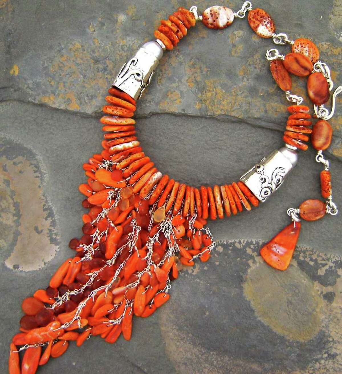 Alina Rominger created this adjustable-length necklace of hand-carved and -cast sterling silver with spiny oyster shells and Mexican fire stones.