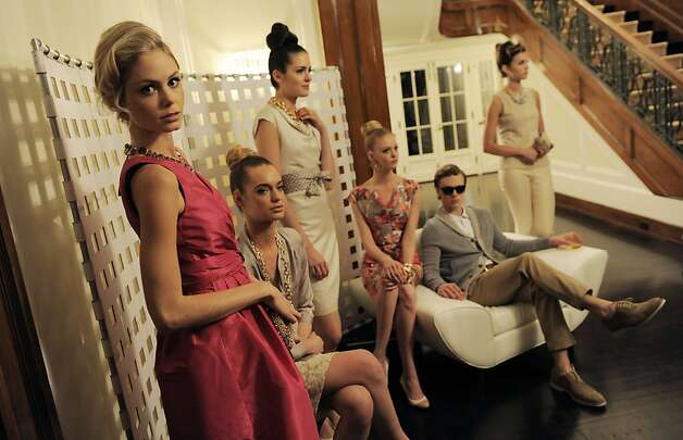 "Models wear ""Mad Men""-inspired apparel at the Banana Republic ""Mad Men"" Collection Launch event in Los Angeles, Wednesday, Feb. 29, 2012. The new collection, which takes inspiration from country club scenes in the ""Mad Men"" television series, will have its in-store debut on Thursday, March 1. (AP Photo/Chris Pizzello) Photo: Chris Pizzello, Associated Press"