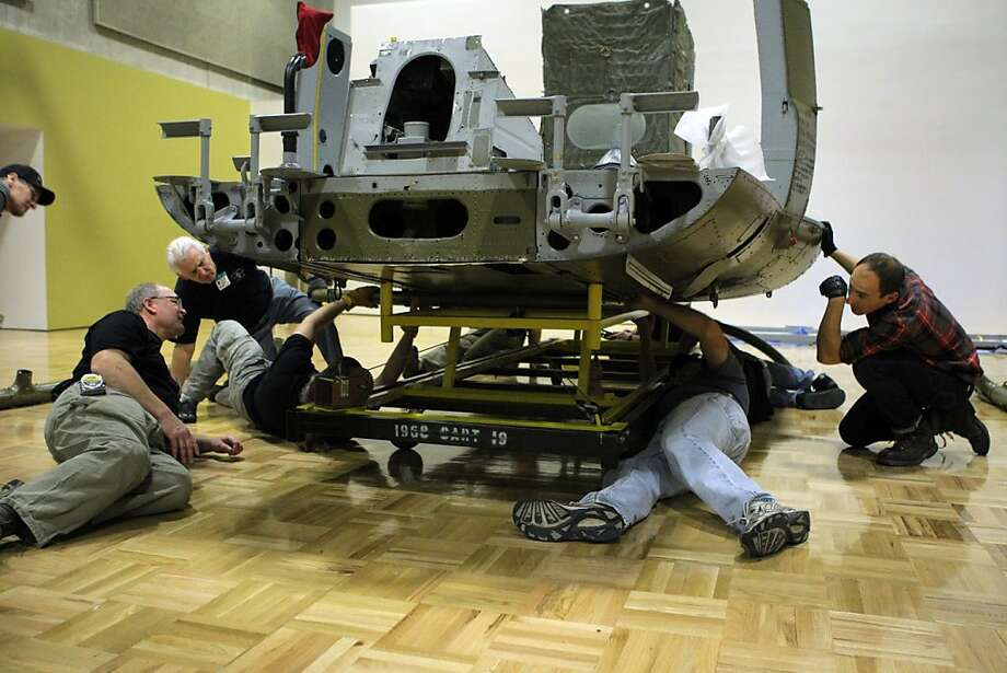 Veterans with the Minnesota Historical Society assemble a replica Huey Helicopter at the Oakland Museum of California on Monday, March 12, 2012, for an upcoming exhibition. Photo: Erik Verduzco, The Chronicle