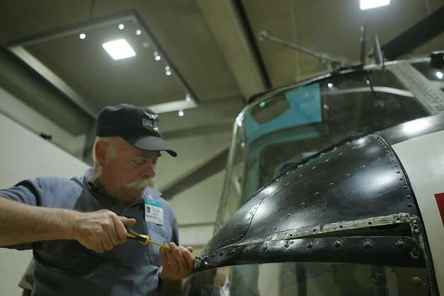 Army Veteran John Dubpernell, helps assemble a Huey Helicopter at the Oakland Museum of California on Monday, March 12, 2012, for an upcoming exhibition. Dubpernell and other veterans with the Minnesota Historical Society traveled from Minnesota to assemble and showcase the historical helicopter model. Photo: Erik Verduzco, The Chronicle