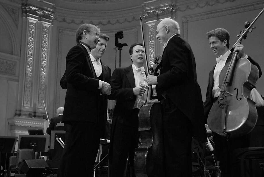 San Francisco Symphony Music Director Michael Tilson Thomas, , Thomas Hampson, Yo-Yo Ma, Michael Grebanier, and Peter Wyrick onstage at Carnegie Hall in 2008  The San Francisco Symphony open Carnegie Hall 2008-2009 season and Leonard Berstein Festival.  Taping the rehearsal for TV, with Dawn Upshaw, Christine Ebersole, Thomas Hampson, and Yo-Yo Ma. Photo: San Francisco Symphony