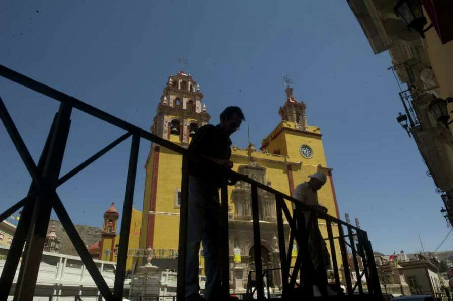 Workers assemble a stage for Pope Benedict XVI  in front of the  Guanajuato basilica to be used duri