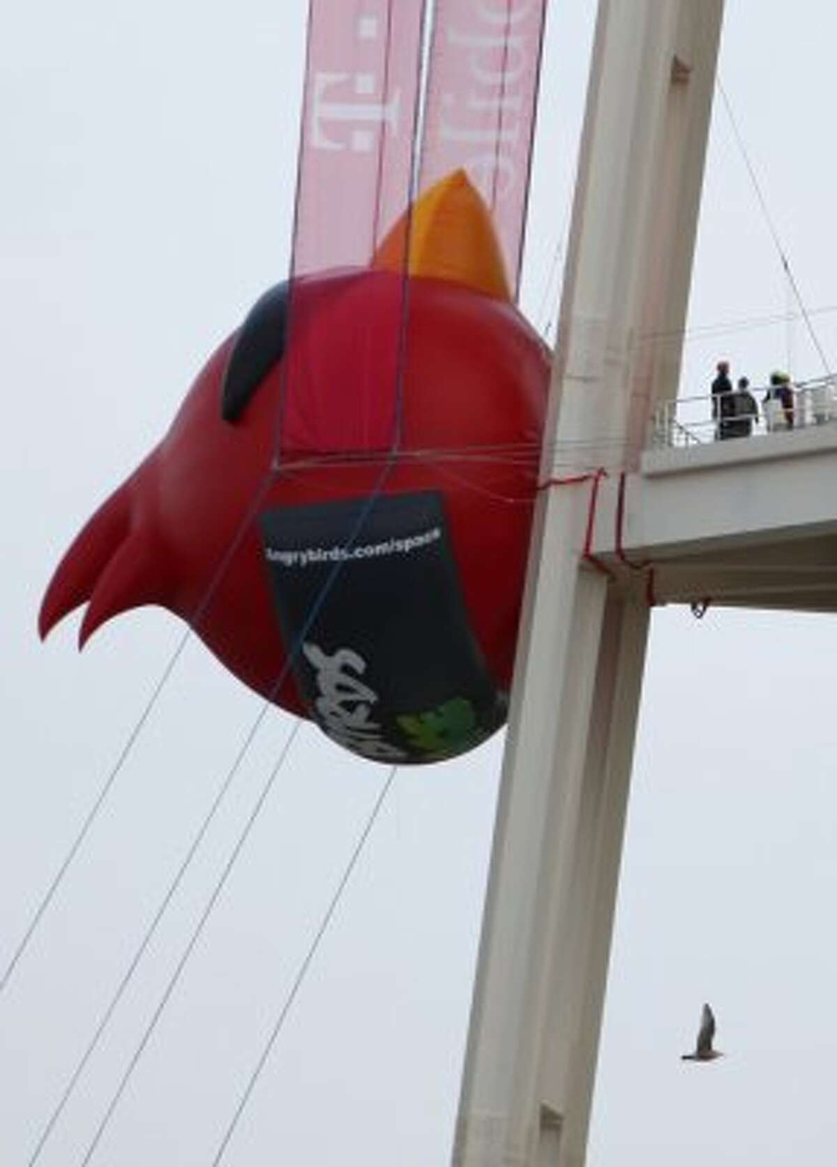 A red 'Angry Bird' is attached to the side of Seattle's Space Needle on Thursday, March 22, 2012 as part of a promotion for the new Angry Birds Space. The Seattle icon was transformed into a giant 'slingshot' for the promotion.