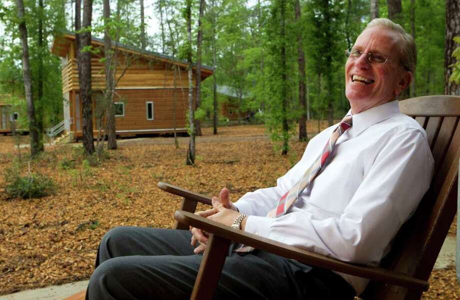Joe Turner, director of the City of Houston Parks and Recreation Department, sits on the porch of one of the newly-built cabins at the Lake Houston Wilderness Park Wednesday, March 21, 2012, in New Caney. Photo: Brett Coomer, Houston Chronicle / © 2012 Houston Chronicle