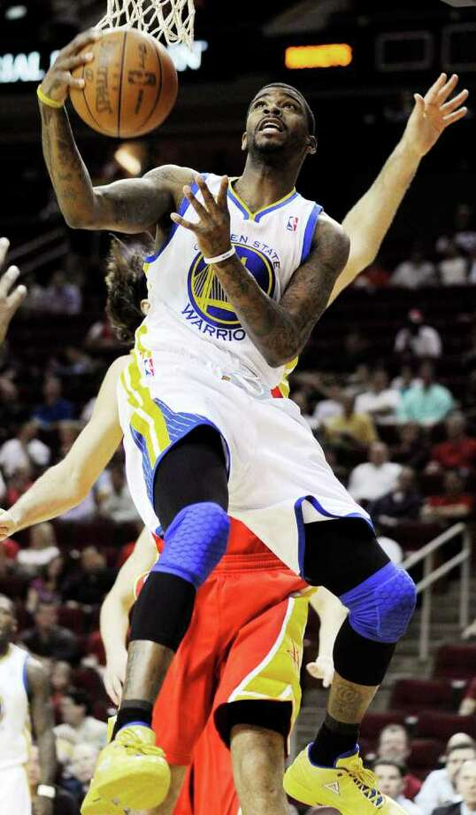 Golden State Warriors' Dorell Wright shoots against the Houston Rockets in the first half of an NBA basketball game, Thursday, March 22, 2012, in Houston. (AP Photo/Pat Sullivan) Photo: Pat Sullivan, Associated Press / AP