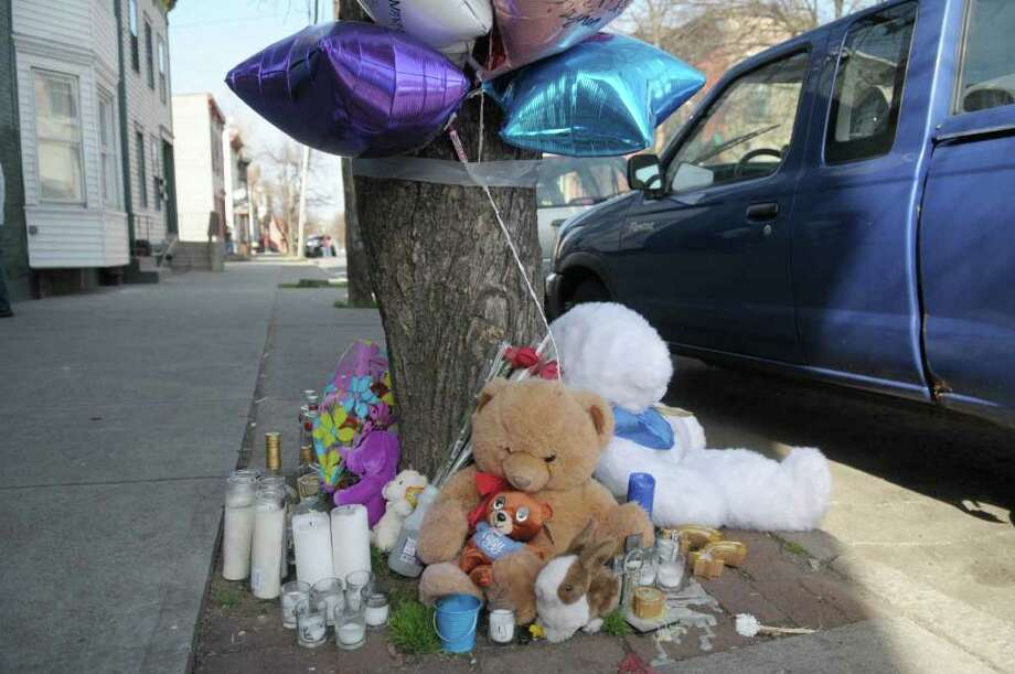 A view of a memorial on 9th Street to 17-year-old Phillip McMillian, seen here on Thursday, March 22, 2012 in Troy, NY.  McMillian was wounded in the head Tuesday night in a drive-by shooting. He later died.     (Paul Buckowski / Times Union) Photo: Paul Buckowski