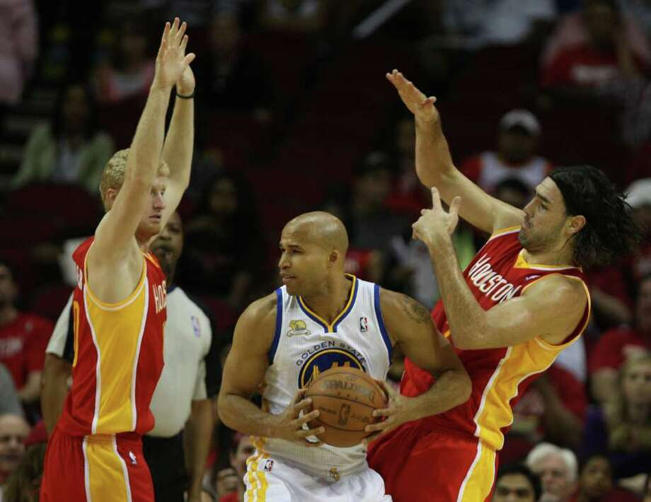 The Houston Rockets Chase Budinger left and Luis Scola right, double-team the Golden State Warriors Richard Jefferson during the first quarter of NBA game action at the Toyota Center Thursday, March 22, 2012, in Houston. Photo: James Nielsen, Chronicle / © 2012 Houston Chronicle